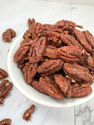 Spiced pecans in a serving bowl