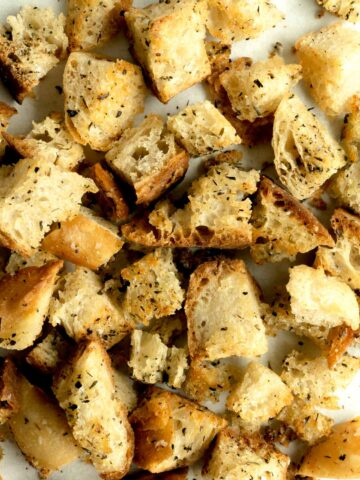 Croutons on a parchment lined sheet pan