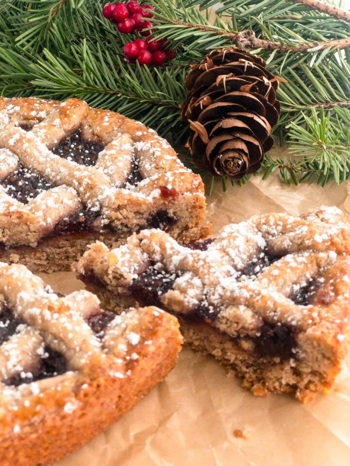 Linzer torte on brown paper with pine cone and pine branch