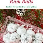 Rum balls on glass plate with white pine cone and pine branch