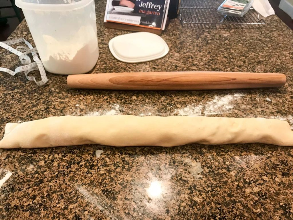 Dough rolled up into a log