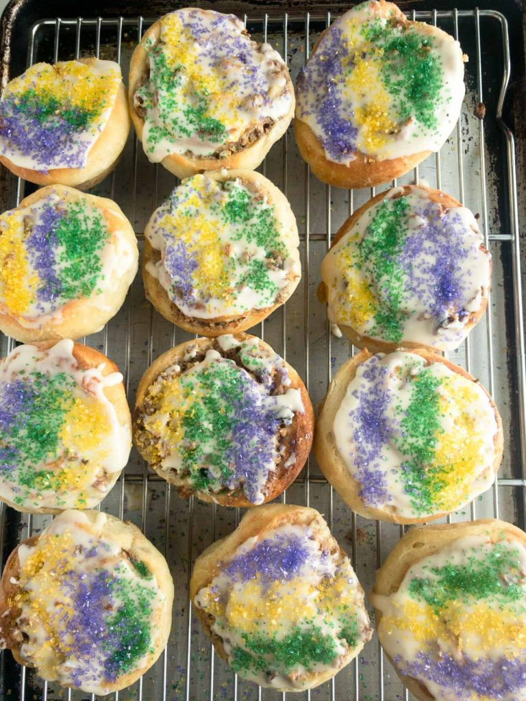 Miniature king cakes on cooling rack