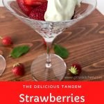 Strawberries and cream in a martini glass on a wood table