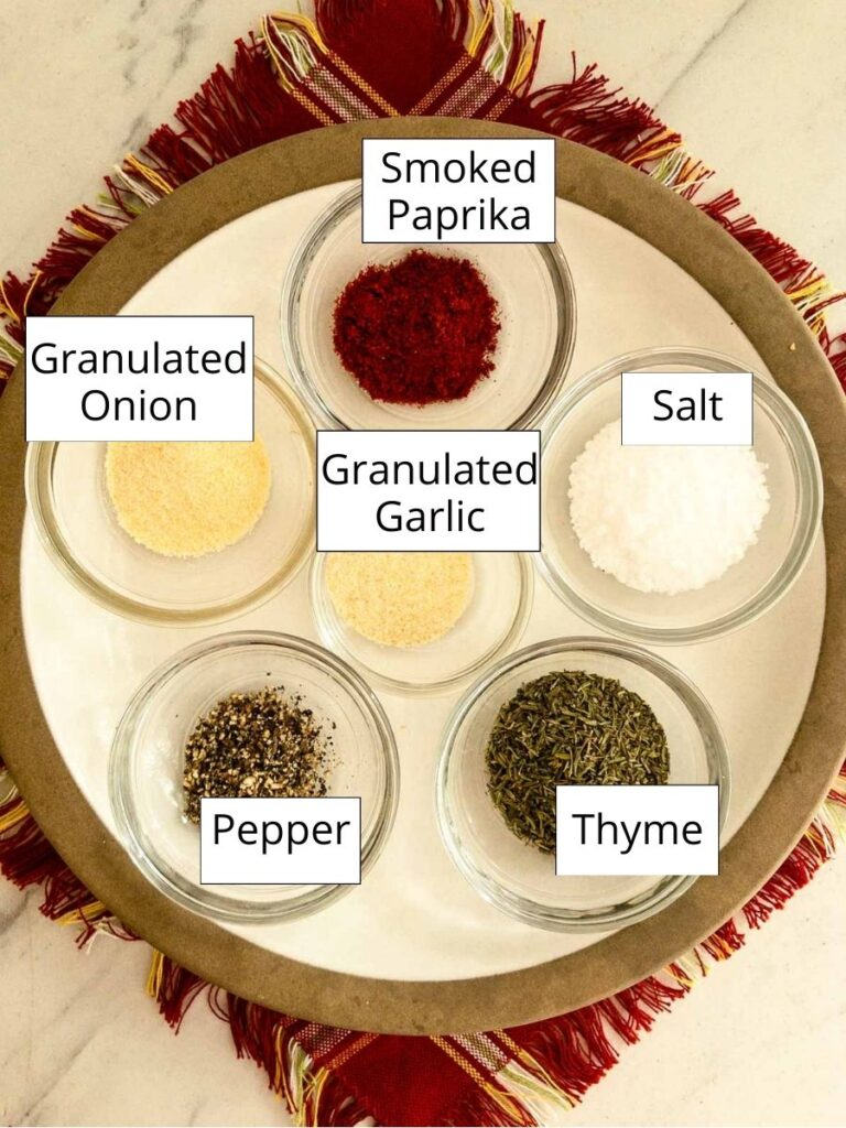 Spices in bowls on a plate