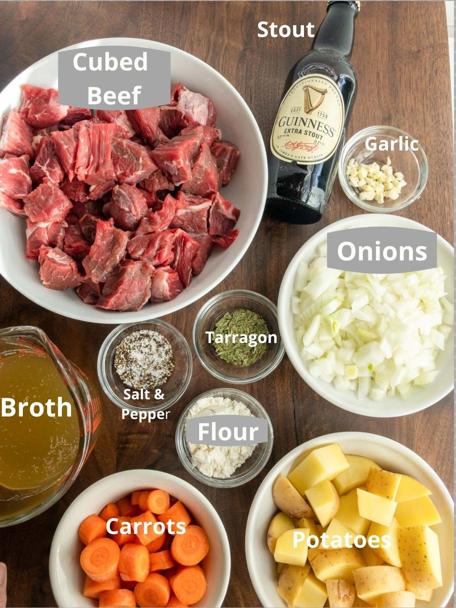 Beef, onions, potatoes, beer, broth, carrots and spices for Irish beef stew