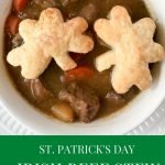 Irish beef stew in a white bowl with two puff pastry shamrocks
