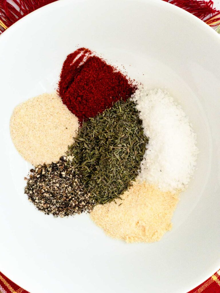 Spices and herbs in a white bowl