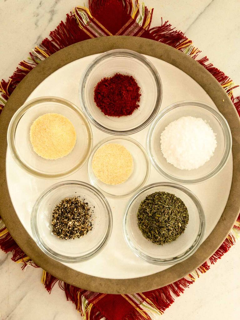Spices in small glass bowls on a plate