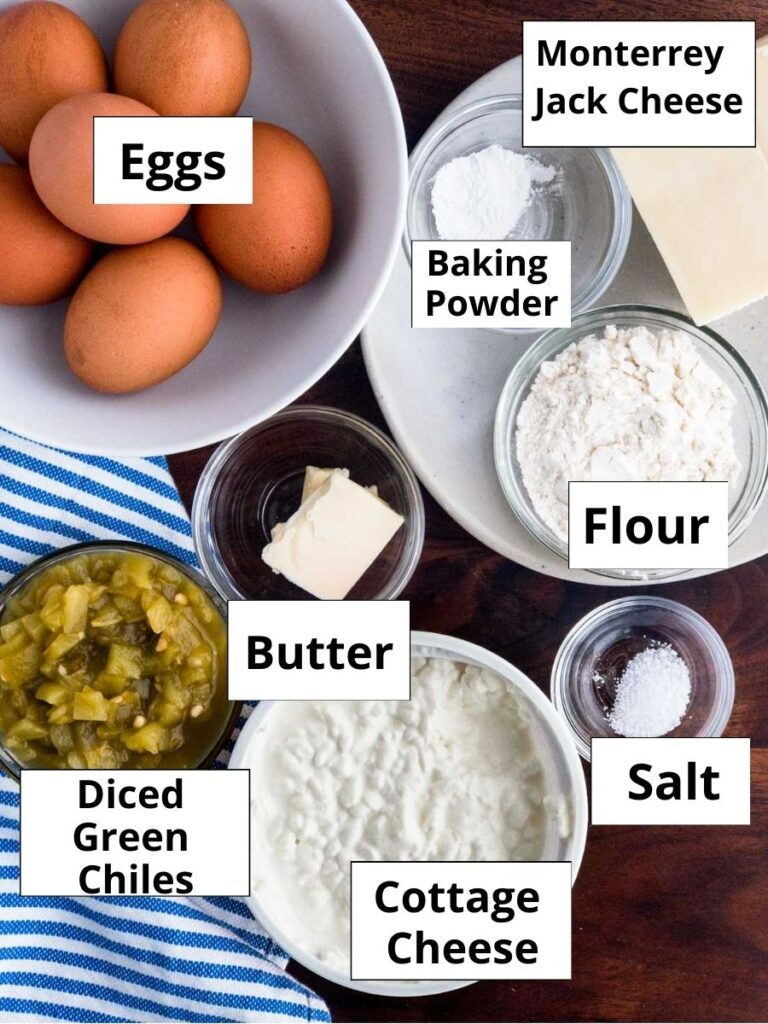 Eggs, flour, cheese, butter cottage cheese, green chilis, salt in individual bowls