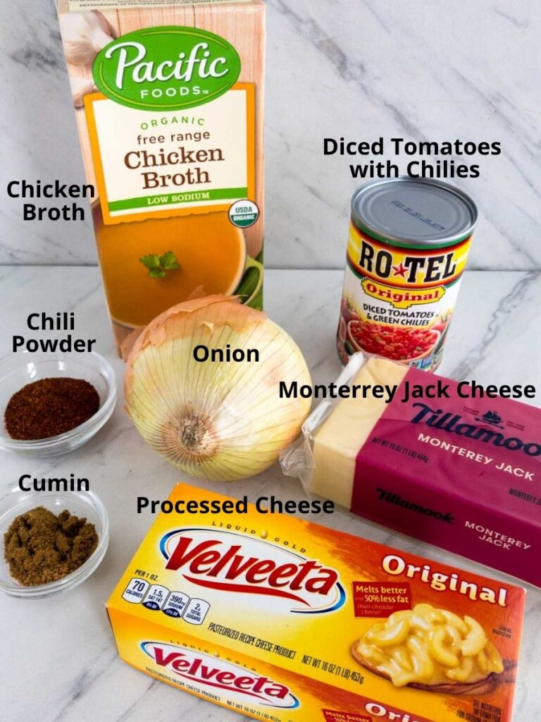 box of chicken broth, onion, can of rotel tomatoes, cumin and chili powder in a small glass bowl, Velveeta cheese, block of Monterey Jack Cheese