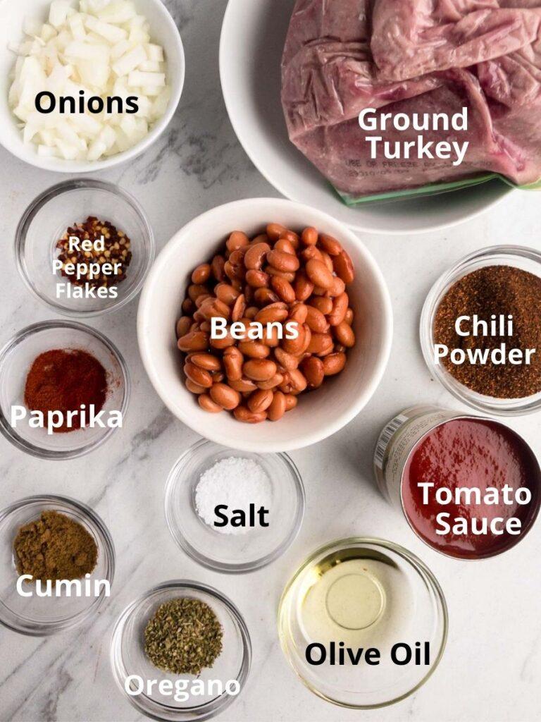 Ingredient to make turkey chili, ground Trunkey, onions, pinto beans, chili powder, salt, cumin, paprika, oregano tomato sauce