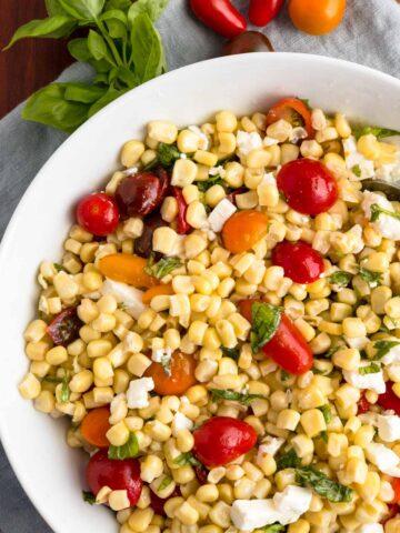 Corn and Tomato Salad in a white bowl